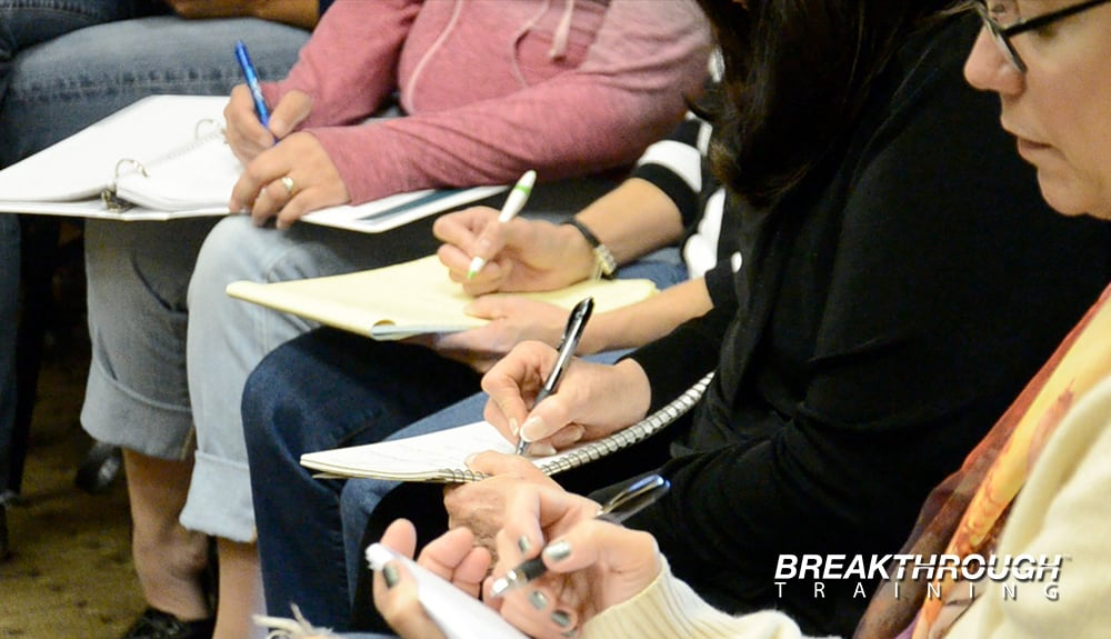 Participants Writing in Journals at a Leadership Training Series in Reno.