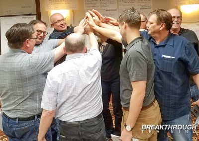 mcewen-mining-leadership-training-managers-breakthrough-high-five