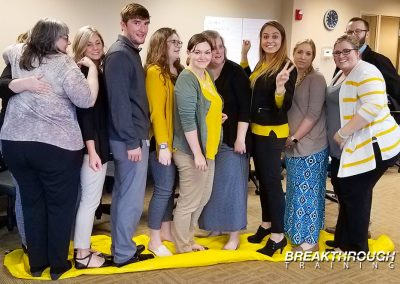 aureus-medical-team-building-training-prgram-omaha-nebraska-yellow-tarp